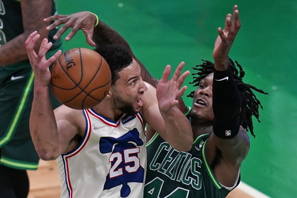Boston Celtics center Robert Williams III, right, tries to block Philadelphia 76ers guard Ben Simmons, left, during the first half of an NBA basketbal...