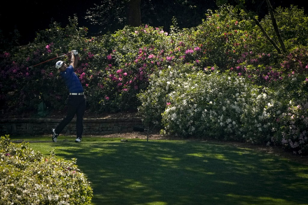Hideki Matsuyama, of Japan, watches his tee shot on the 13th hole during a practice round for the Masters golf tournament on Tuesday, April 6, 2021, i...