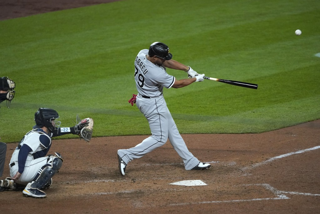 Chicago White Sox's Jose Abreu hits a grand slam during the eighth inning of the team's baseball game against the Seattle Mariners, Tuesday, April 6, ...