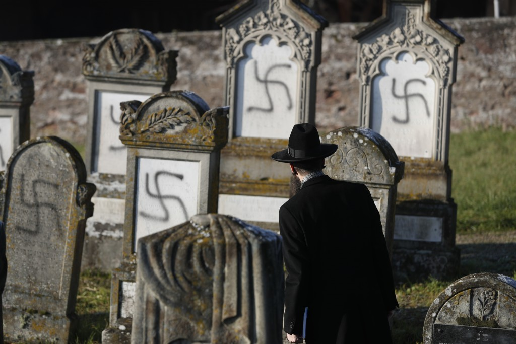 FILE - In this Dec. 4, 2019 file photo, Strasbourg chief Rabbi Harold Abraham Weill looks at vandalized tombs in the Jewish cemetery of Westhoffen, we...