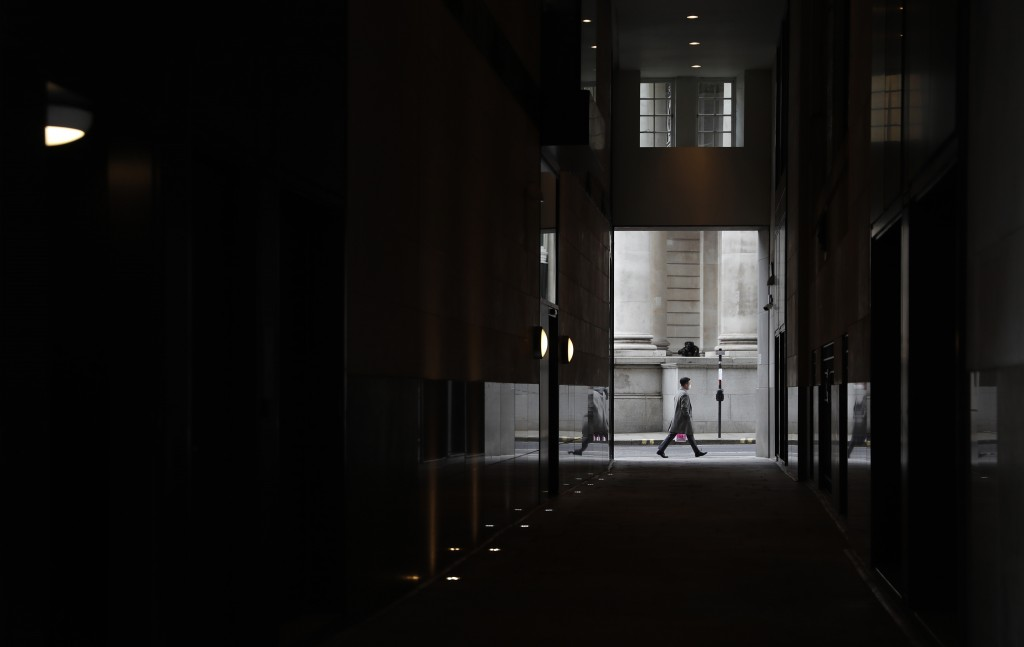 A man walks past the Royal Exchange in London, Tuesday, April 6, 2021. When the pandemic struck, about 540,000 workers vanished from London's financia...