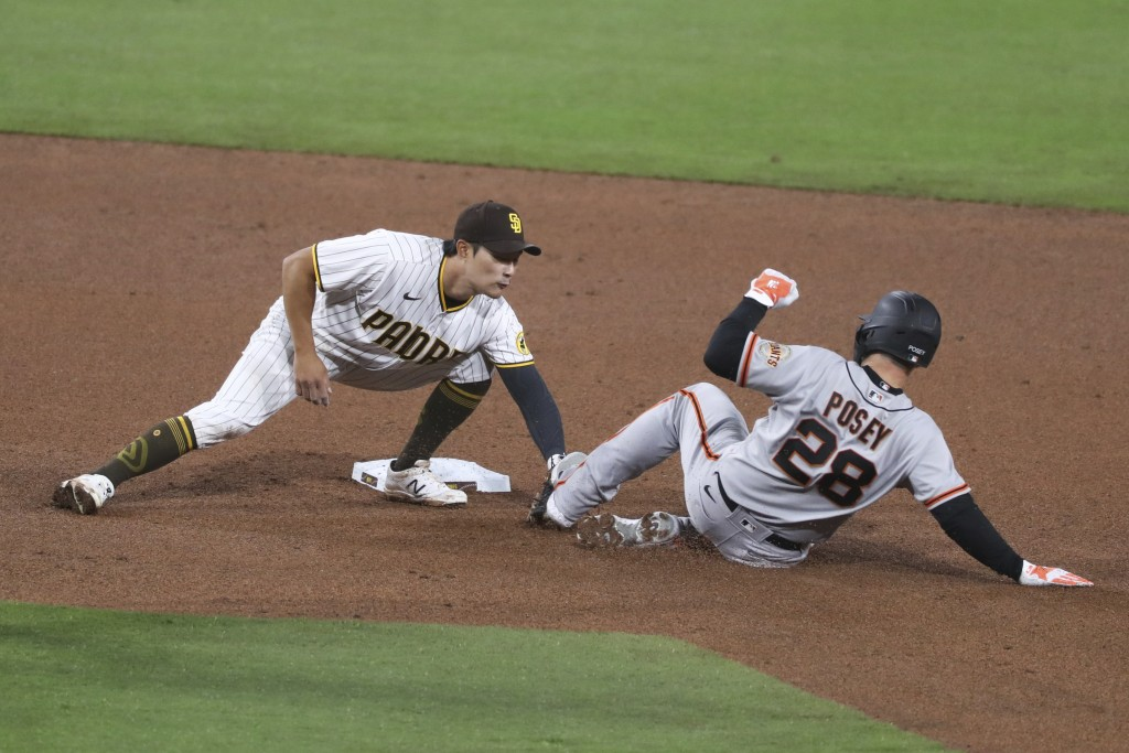 San Diego Padres shortstop Ha-Seong Kim tags out San Francisco Giants Buster Posey on a double play in the fifth inning of a baseball game Tuesday, Ap...