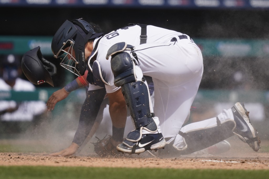 Detroit Tigers catcher Grayson Greiner tags out Minnesota Twins' Jorge Polanco for the out during the fifth inning of a baseball game, Tuesday, April ...
