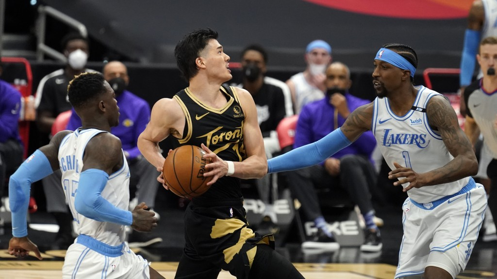 Toronto Raptors forward Yuta Watanabe, of Japan, (18) goes for a shot after getting past Los Angeles Lakers guard Dennis Schroder (17) and guard Kenta...