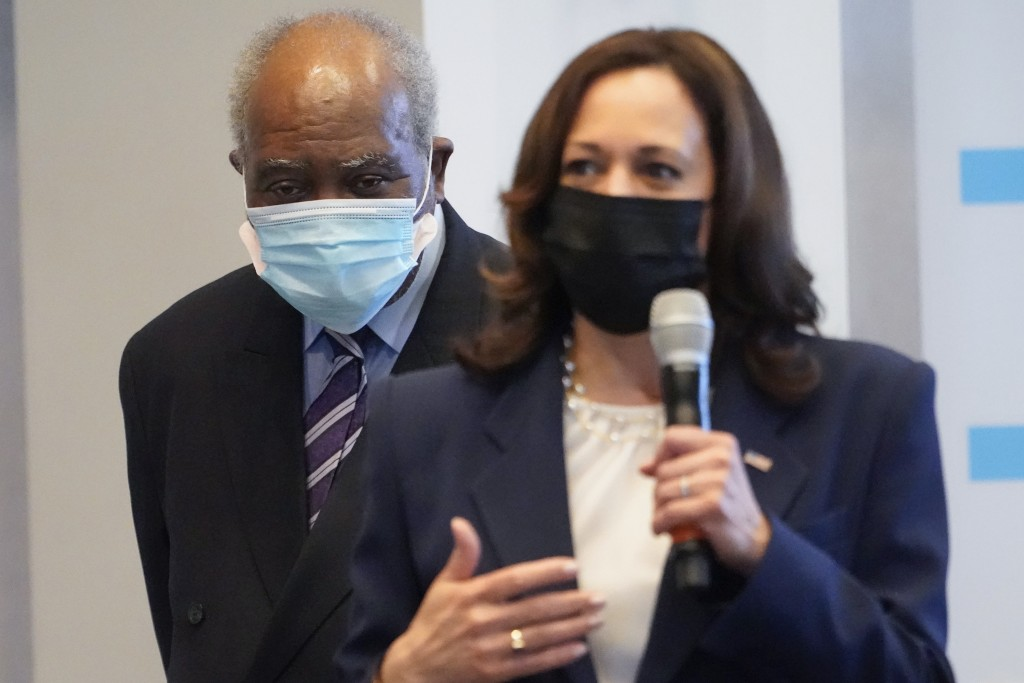 Vice President Kamala Harris speaks during a visit to a COVID-19 vaccination site Tuesday, April 6, 2021, in Chicago, as Rep. Danny Davis, D-Ill., lis...