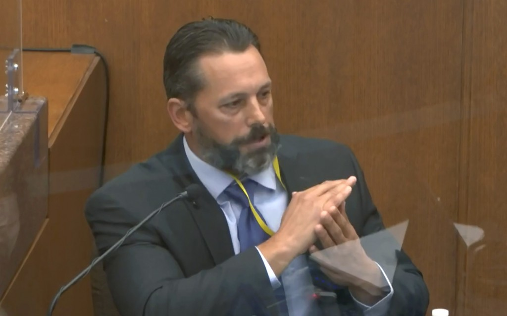In this image from video, Minneapolis Police Lt. Johnny Mercil, a use of force trainer, testifies as Hennepin County Judge Peter Cahill presides Tuesd...