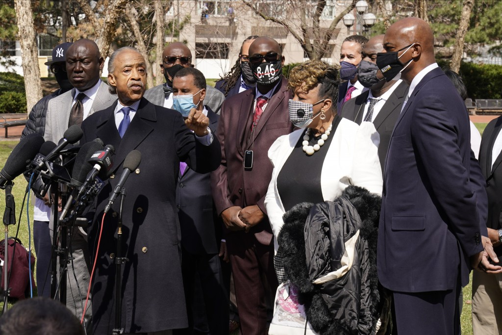 The Rev. Al Sharpton, left, addresses the media before giving a prayer as he, members of George Floyd's family along with Gwen Carr, the mother of Eri...