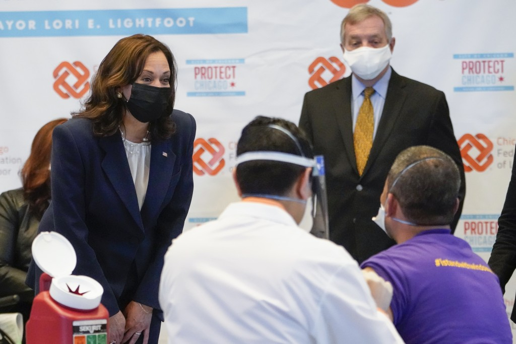 Vice President Kamala Harris talks with Lucio Polanco, a high-rise window washer, as he gets the Johnson & Johnson COVID-19 vaccination from Osman Mea...