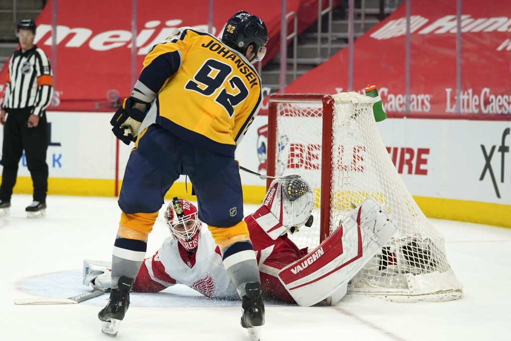 Nashville Predators center Ryan Johansen (92) scores a shootout goal against Detroit Red Wings goaltender Thomas Greiss (29) during an NHL hockey game...