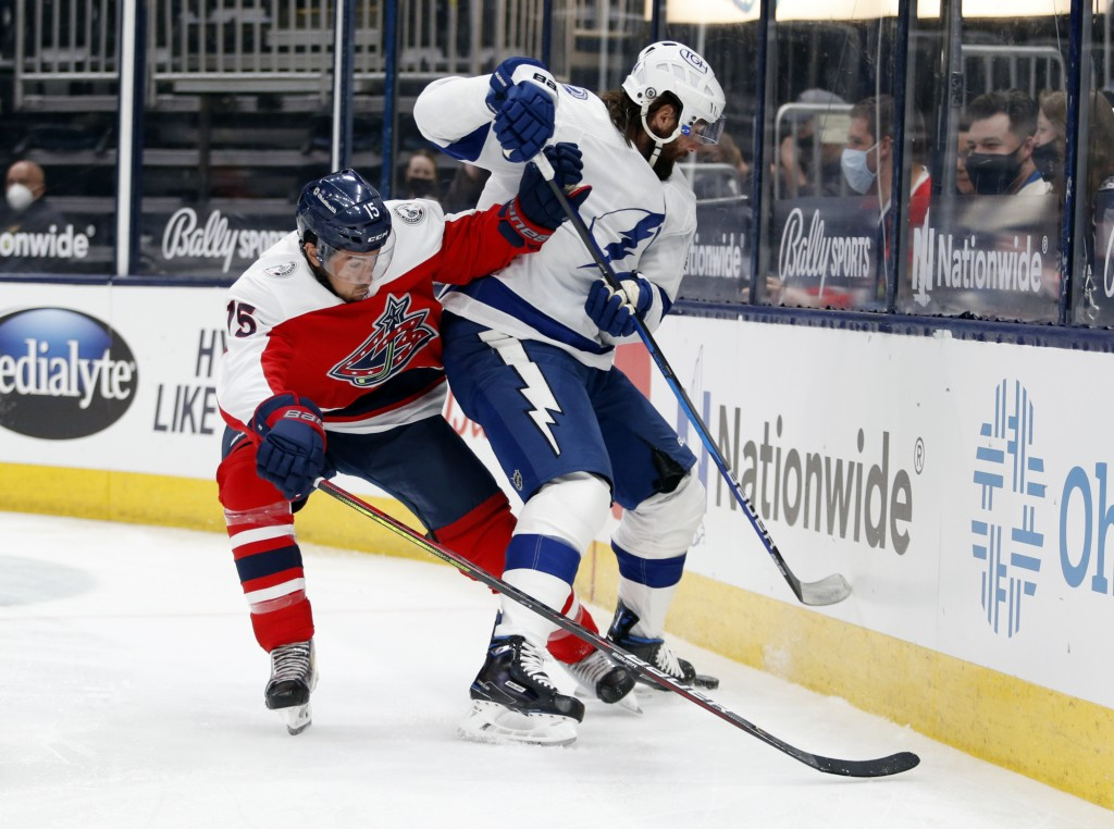 Columbus Blue Jackets defenseman Michael Del Zotto, left, works against Tampa Bay Lightning forward Pat Maroon during the first period of an NHL hocke...