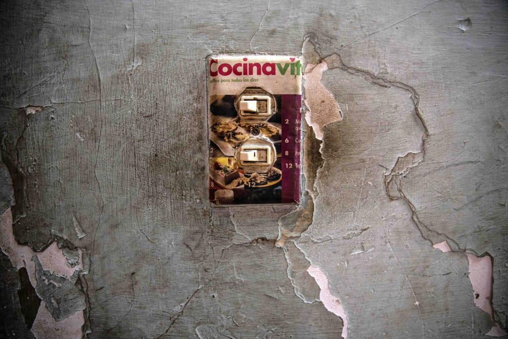 A makeshift light switch plate is decorated with an image of baked goods in the home of Yuliet Colon, a 39-year-old mother of two and a contributor to...