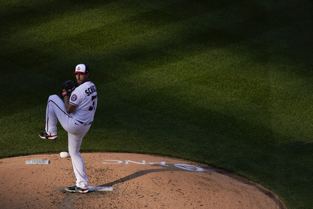 Washington Nationals starting pitcher Max Scherzer throws to the Atlanta Braves in the sixth inning of an opening day baseball game at Nationals Park,...