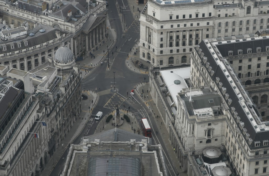 A view over the City of London looking at the Bank of England, right, from the 59th floor of 22 Bishopsgate in London, Thursday, April 1, 2021. When t...