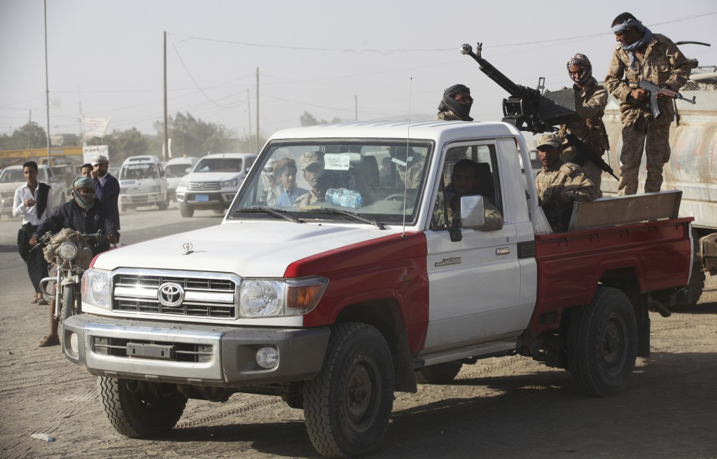 FILE - In this Feb. 2, 2018, file photo, Yemeni soldiers allied to the country's internationally recognized government stand guard in Marib, Yemen. Th...