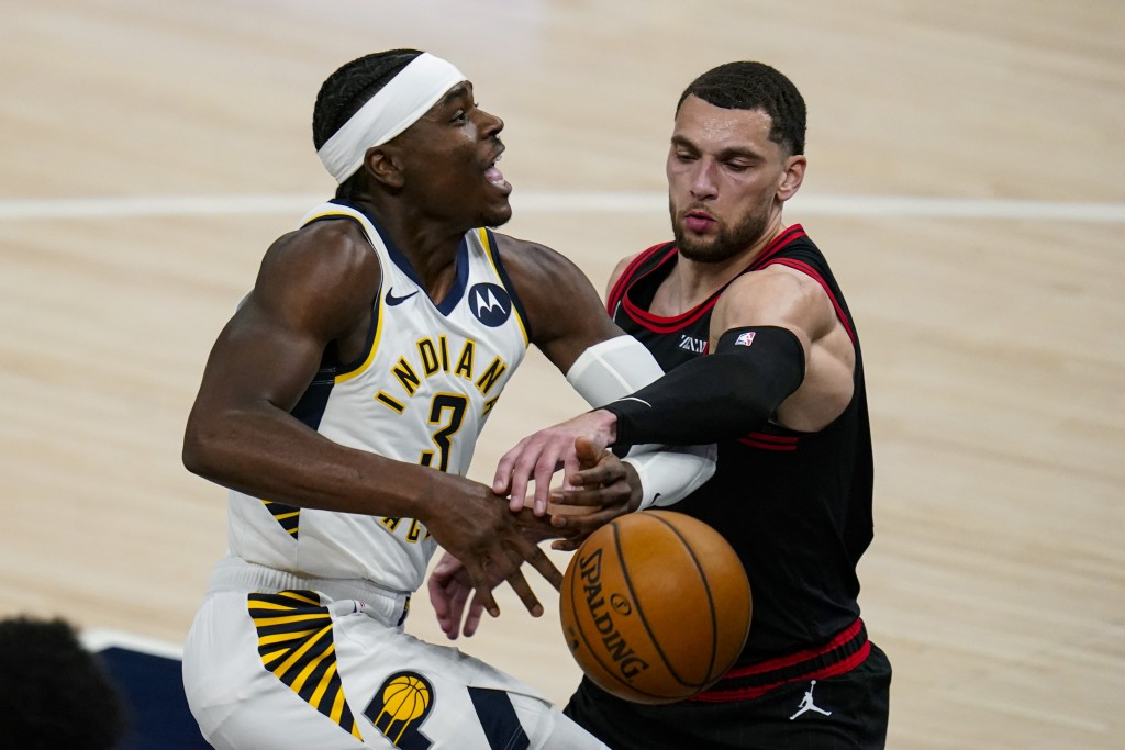 Indiana Pacers guard Aaron Holiday (3) is fouled by Chicago Bulls guard Zach LaVine during the first half of an NBA basketball game in Indianapolis, T...