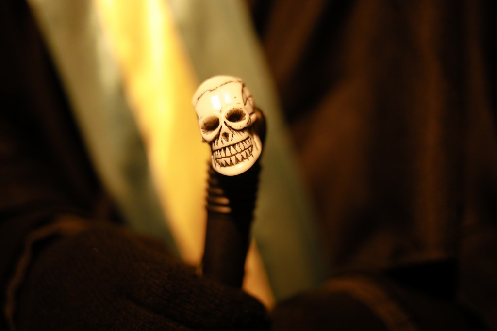 Brazilian activist and artist Rafael Puetter, holds his walking stick, decorated with a small skull, prior to his one-man protest through Berlin, Germ...