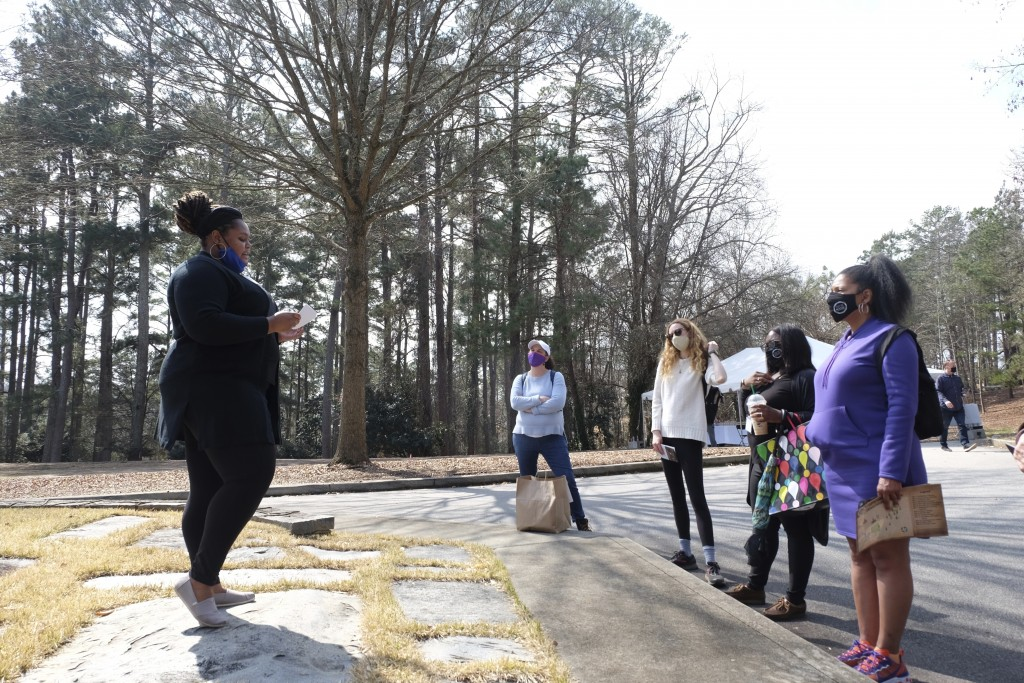 Marisa Davis, a graduate student at Clemson University, talks to a group touring Woodland Cemetery on campus in Clemson, S.C. on Sunday, Feb. 28, 2021...