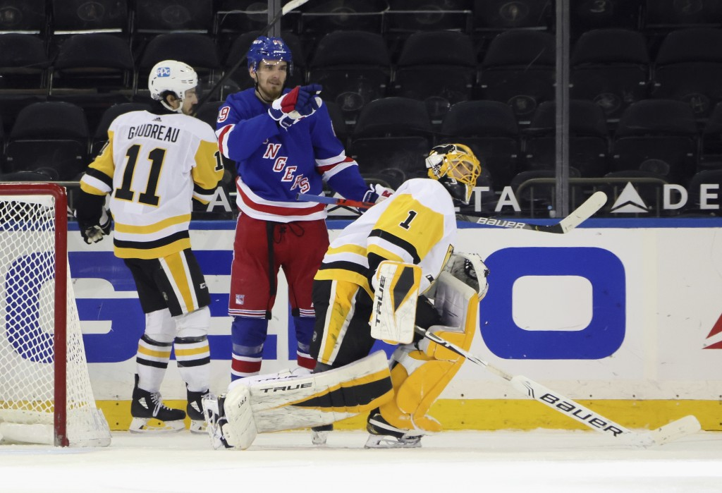 New York Rangers' Pavel Buchnevich celebrates his goal against Pittsburgh Penguins goalie Casey DeSmith during the third period of an NHL hockey game ...
