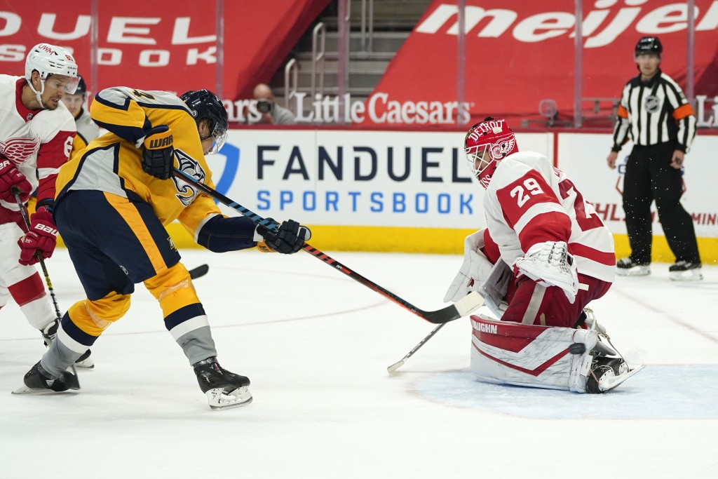Nashville Predators center Mikael Granlund (64) scores on Detroit Red Wings goaltender Thomas Greiss (29) in the third period of an NHL hockey game Tu...