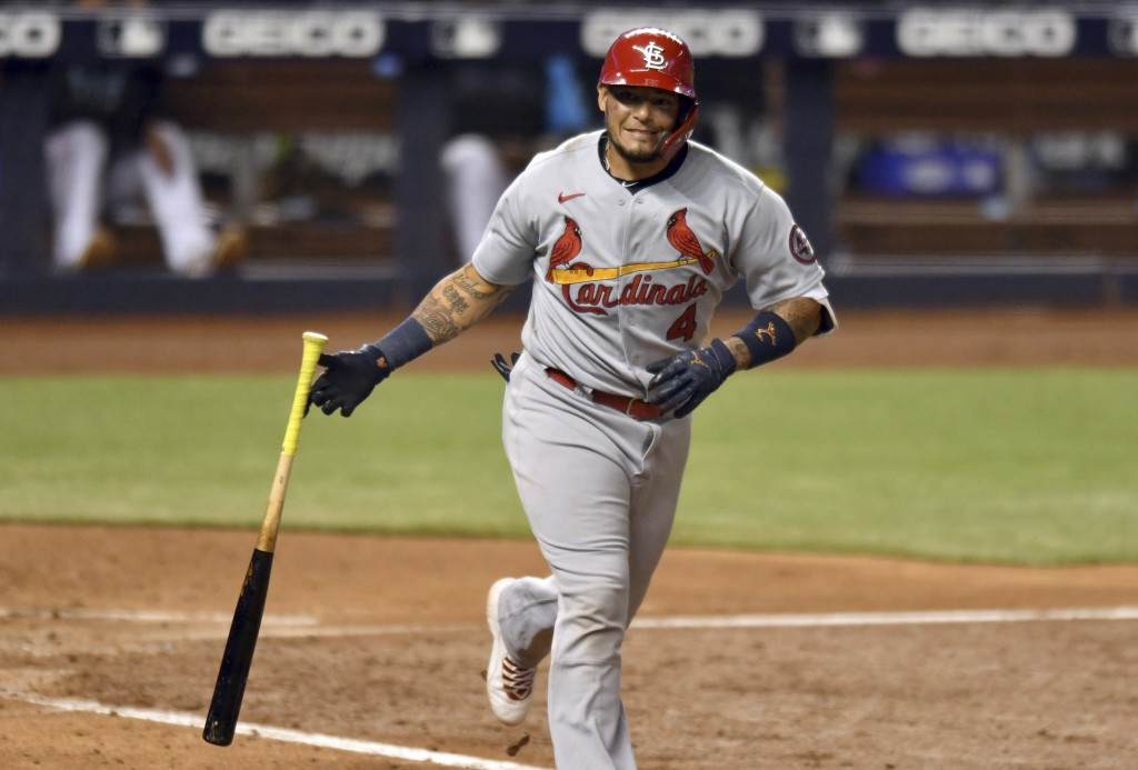 St. Louis Cardinals' Yadier Molina drops his bat after hitting a sacrifice fly during the sixth inning of the team's baseball game against the Miami M...