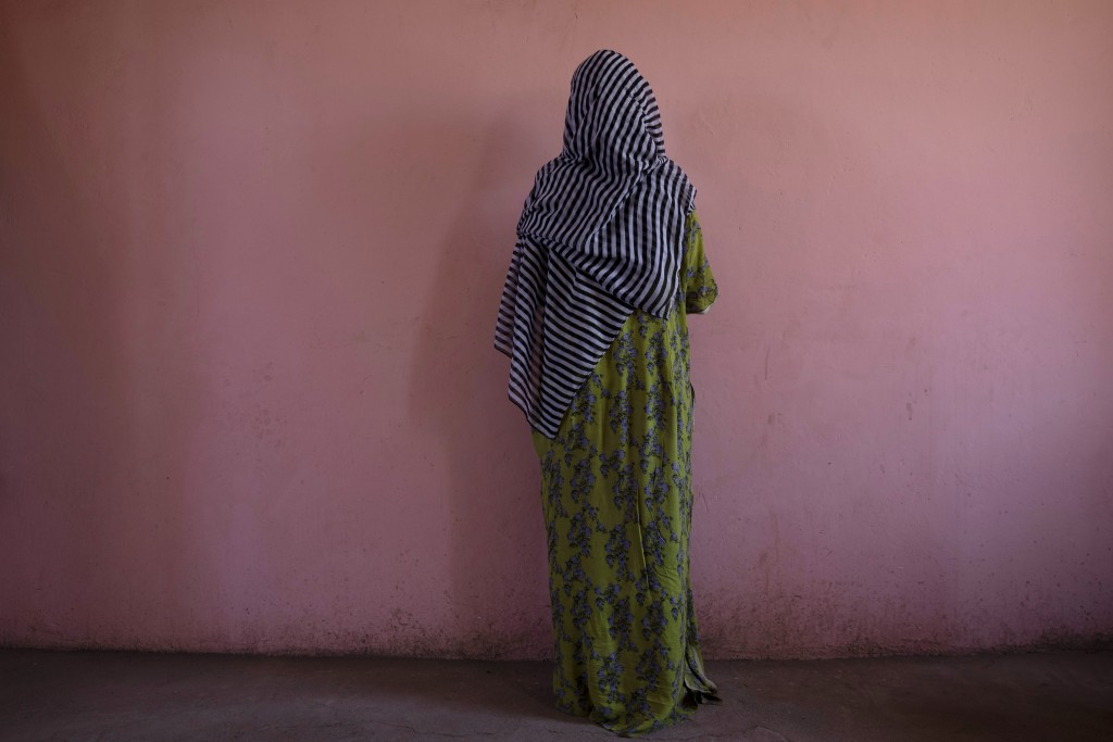 A Tigrayan woman who says she was gang raped by Amhara fighters, stands for a portrait in eastern Sudan, near the border with Ethiopia, on March 23, 2...
