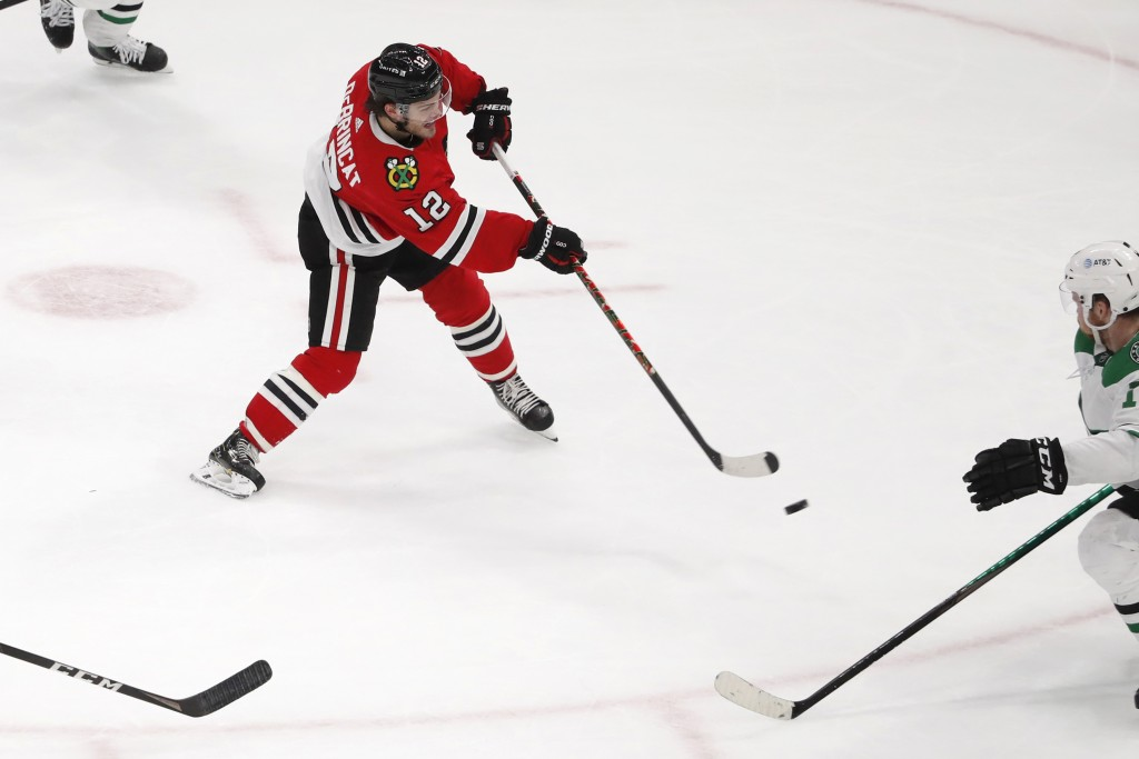 Chicago Blackhawks left wing Alex DeBrincat (12) shoots the puck for a goal against the Dallas Stars during the second period of an NHL hockey game Tu...