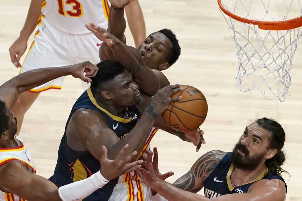 New Orleans Pelicans forward Zion Williamson (1) tries to get to the basket as Atlanta Hawks forward Onyeka Okongwu (17) defends in the first half of ...