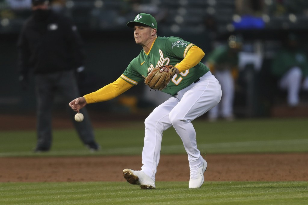 Oakland Athletics third baseman Matt Chapman can't field a single hit by Los Angeles Dodgers' Austin Barnes during the fourth inning of a baseball gam...