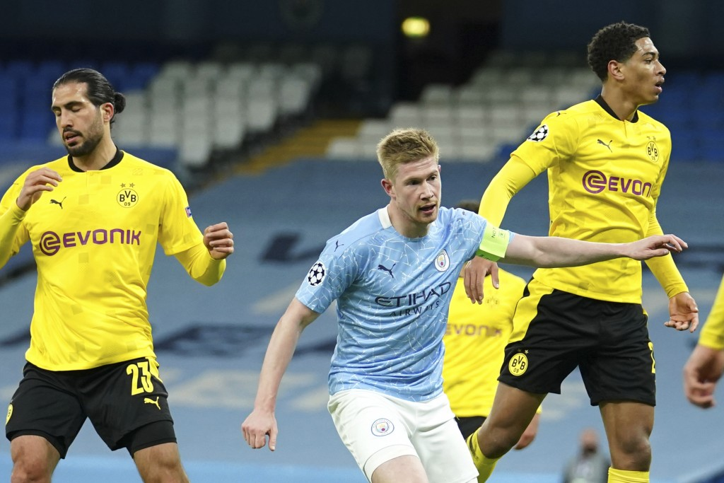 Manchester City's Kevin De Bruyne, center, celebrates after scoring his side's first goal during the Champions League, first leg, quarterfinal soccer ...