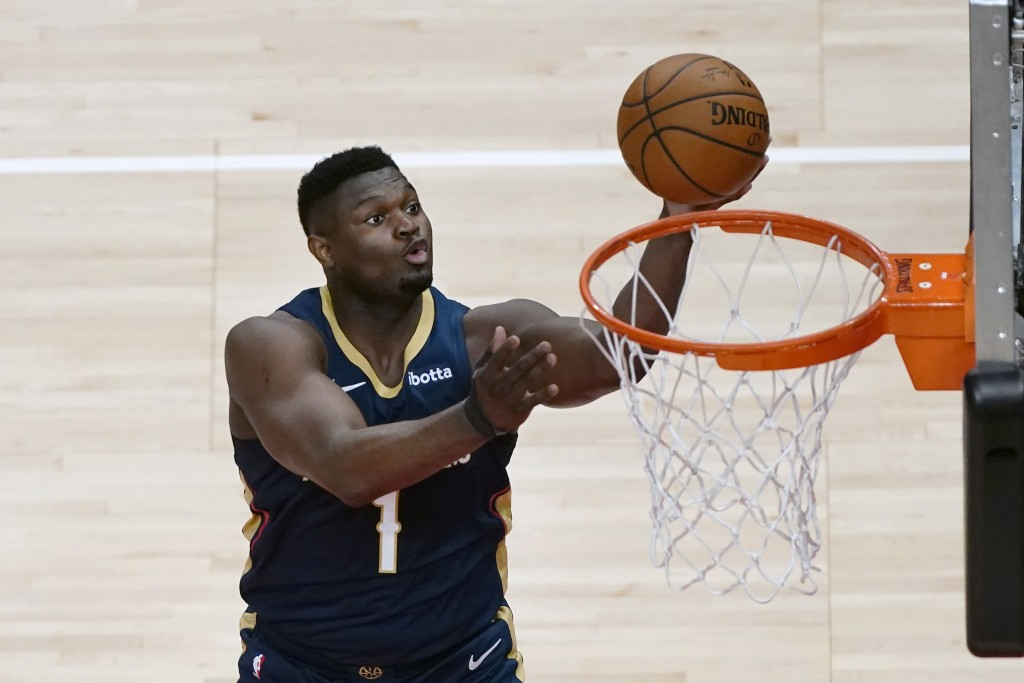New Orleans Pelicans forward Zion Williamson (1) scores against the Atlanta Hawks in the first half of an NBA basketball game Tuesday, April 6, 2021, ...