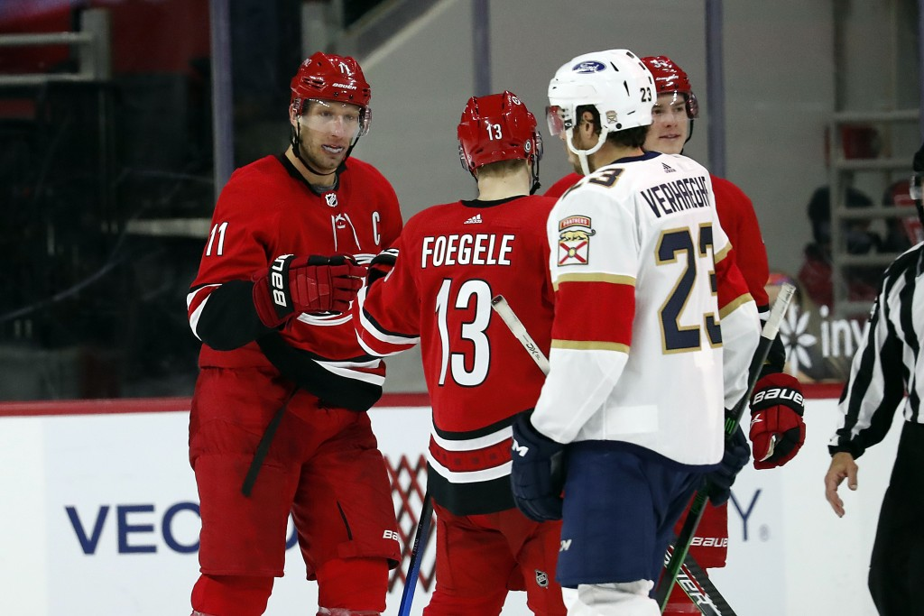 Carolina Hurricanes' Jordan Staal (11) is congratulated on his goal by teammates Warren Foegele (13) and Andrei Svechnikov (37) with Florida Panthers'...