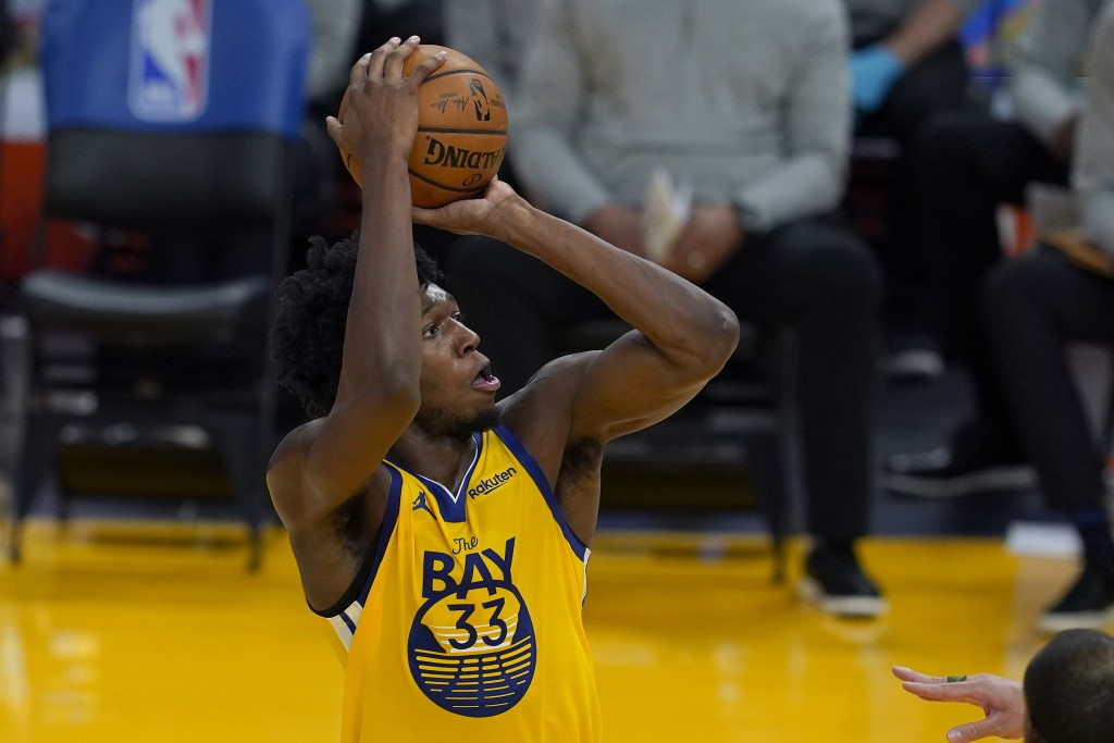 Golden State Warriors center James Wiseman (33) shoots against the Milwaukee Bucks during the first half of an NBA basketball game in San Francisco, T...