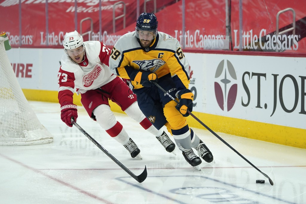Nashville Predators defenseman Roman Josi (59) protects the puck from Detroit Red Wings left wing Adam Erne (73) in the second period of an NHL hockey...
