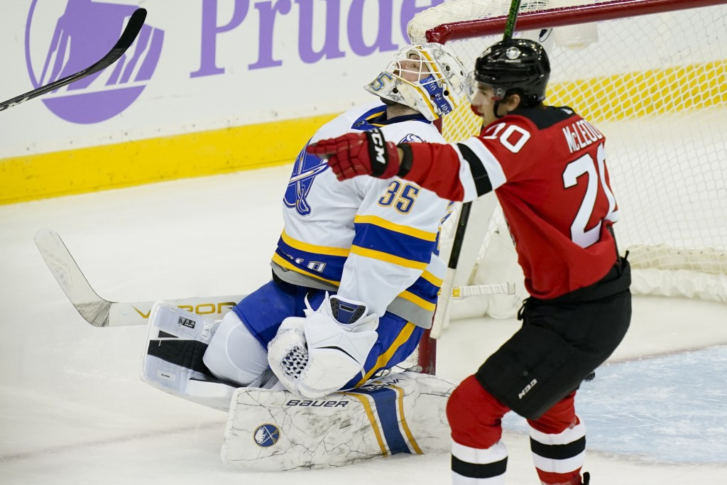 Buffalo Sabres goaltender Michael Houser (35) reacts after giving up a goal to New Jersey Devils defenseman Damon Severson, not seen, during the first...