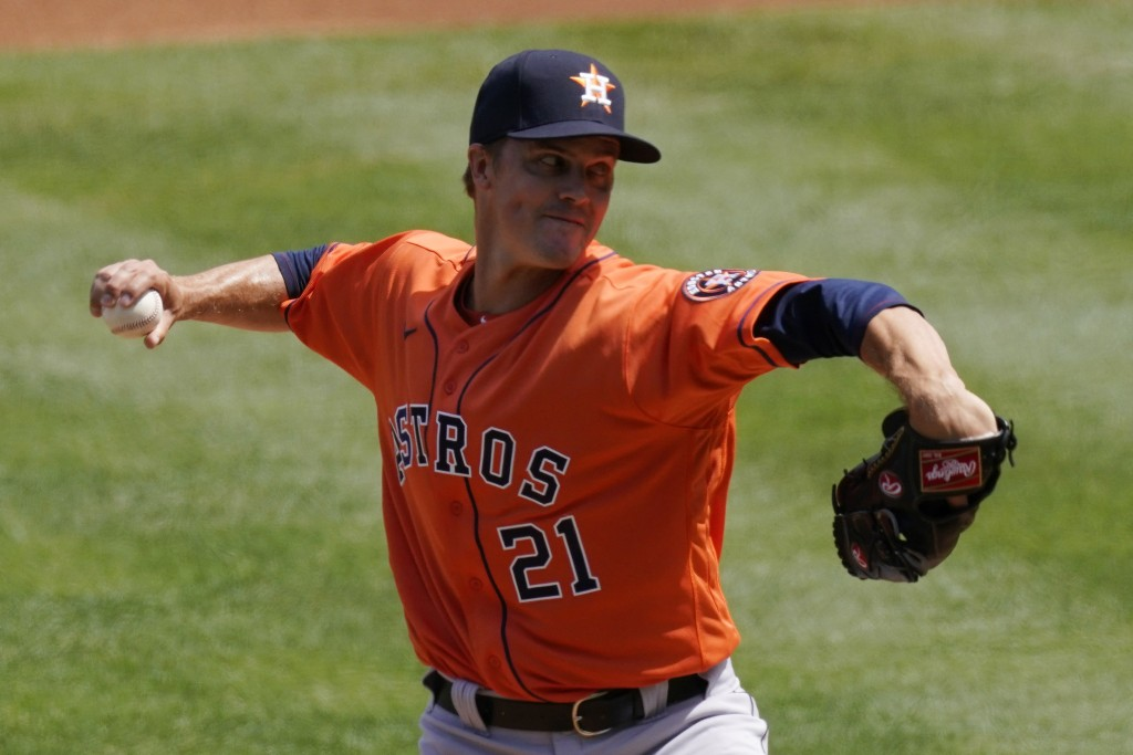 Houston Astros starting pitcher Zack Greinke throws to the plate during the first inning of a baseball game against the Los Angeles Angels Tuesday, Ap...