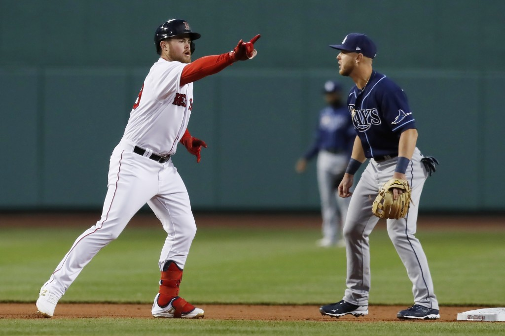 Boston Red Sox's Christian Arroyo, left, reacts next to Tampa Bay Rays' Michael Brosseau after hitting a double during the first inning of a baseball ...