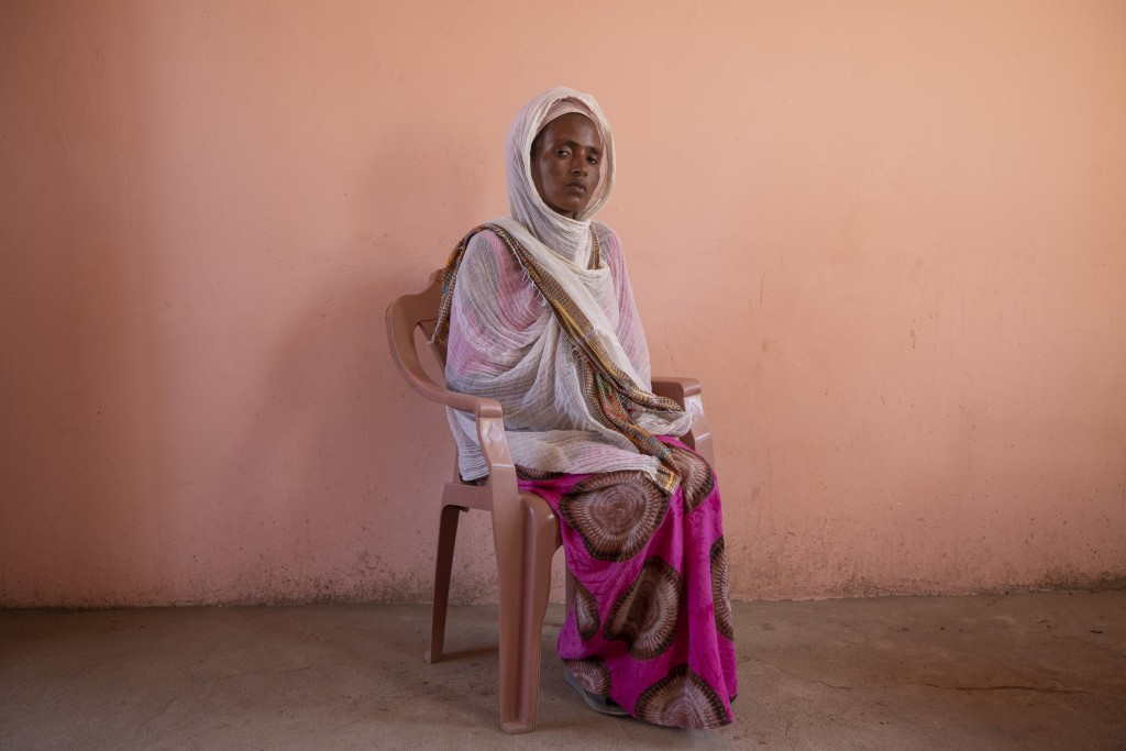 Tigrayan refugee Alem Mebrahtu, 30, who fled the conflict in Ethiopia's Tigray, sits for a portrait in eastern Sudan, near the border with Ethiopia, o...