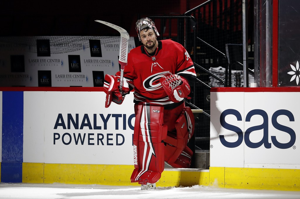 Carolina Hurricanes goaltender Petr Mrazek (34) salutes the fans following the game against the Florida Panthers at an NHL hockey game in Raleigh, N.C...