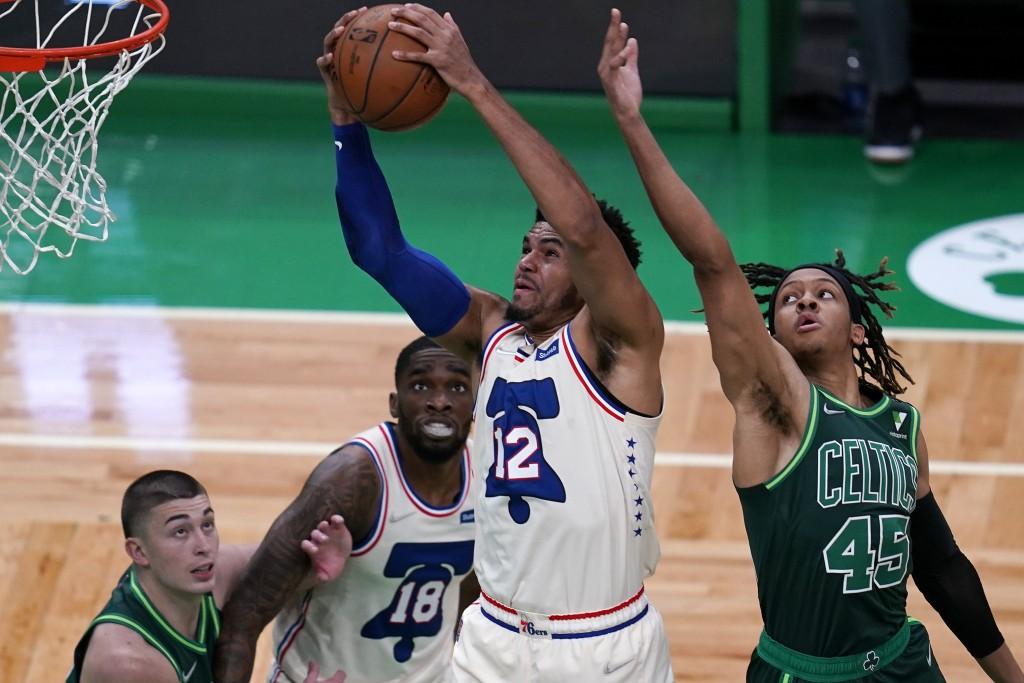 Philadelphia 76ers forward Tobias Harris (12) grabs a rebound against Boston Celtics guard Romeo Langford (45) during the first half of an NBA basketb...