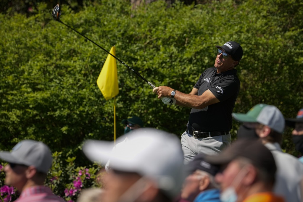 Phil Mickelson watches his tee shot on the 14th hole during a practice round for the Masters golf tournament on Tuesday, April 6, 2021, in Augusta, Ga...