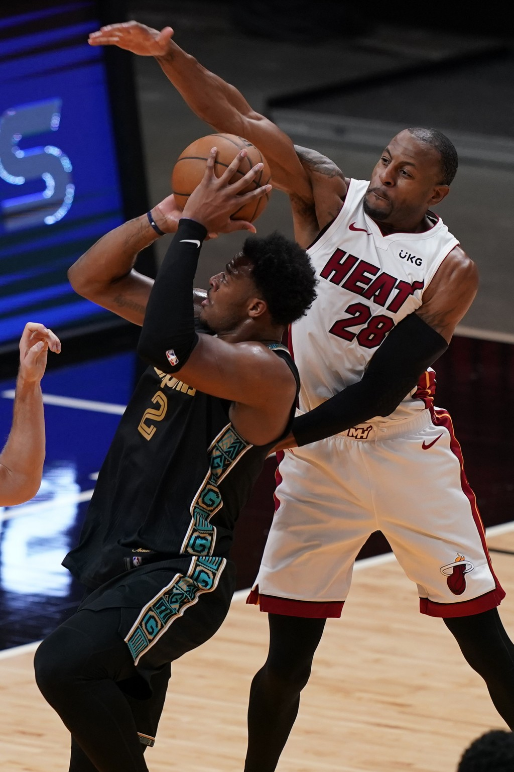 Miami Heat forward Andre Iguodala (28) defends Memphis Grizzlies center Xavier Tillman (2), during the first half of an NBA basketball game, Tuesday, ...