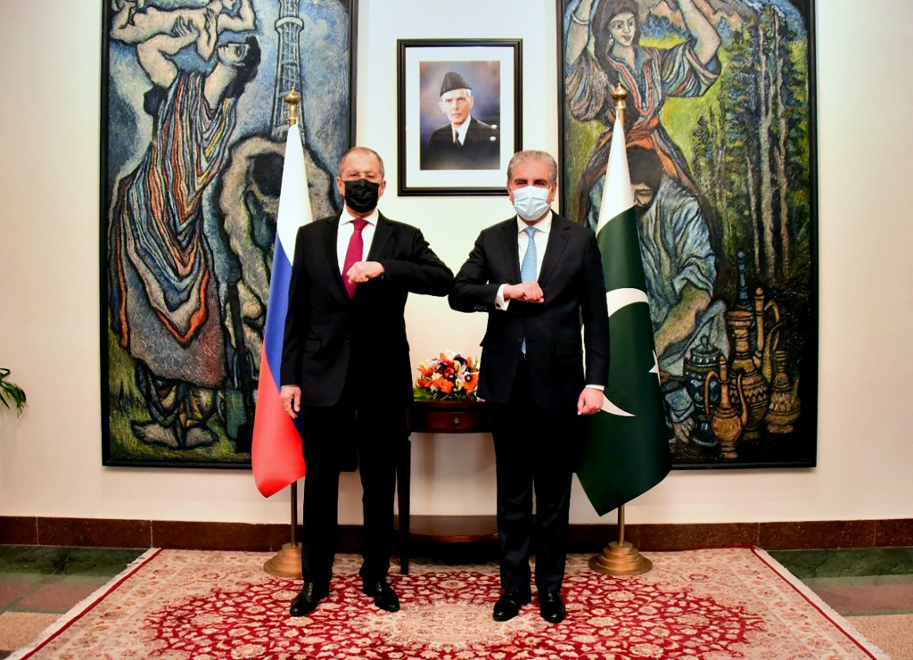 In this photo handout photo released by Pakistan's Ministry of Foreign Affairs, Russia's Foreign Minister Sergey Lavrov, left, bumps elbows with his P...