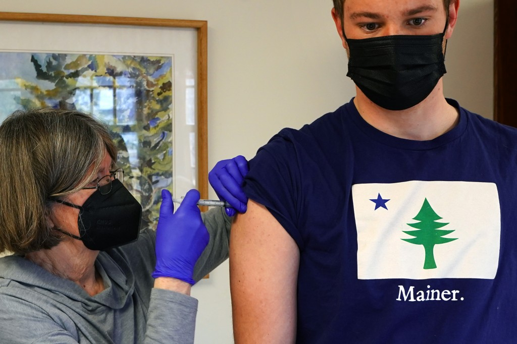 Nurse Sharon Daley administers a COVID-19 vaccination to Oliver Blank, 18, Friday, March 19, 2021, on the island of Islesford, Maine. An exemption has...