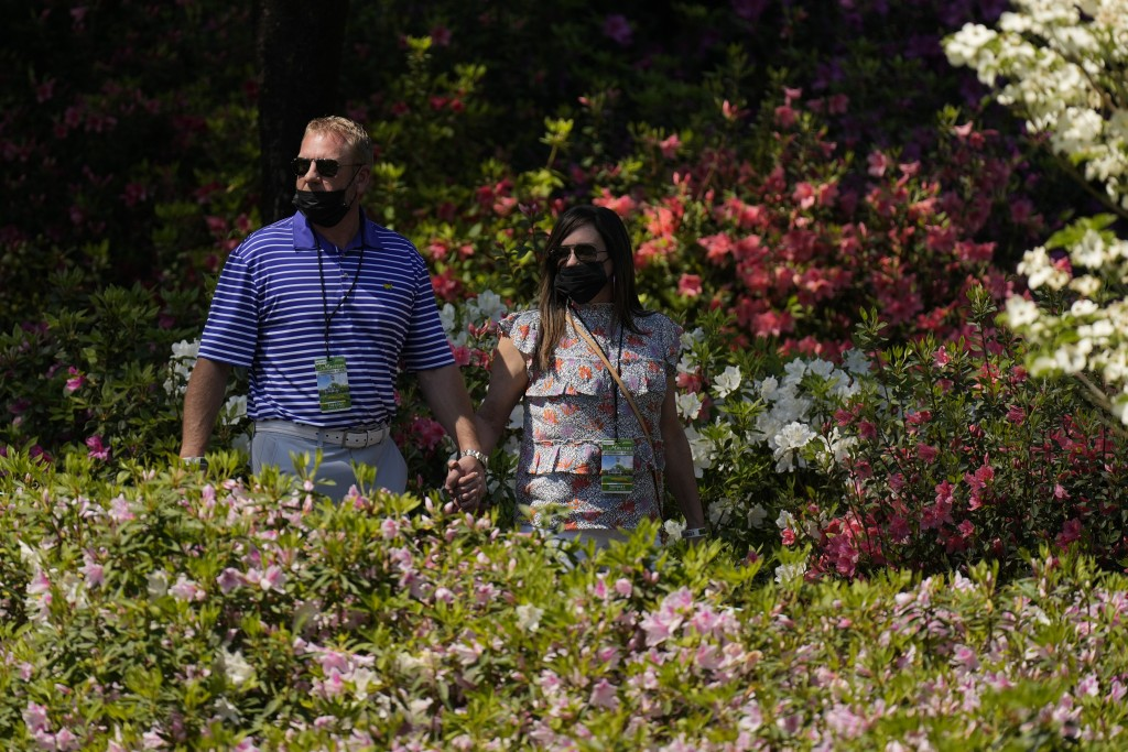 Patrons walk along the sixth hole during a practice round for the Masters golf tournament on Tuesday, April 6, 2021, in Augusta, Ga. (AP Photo/Matt Sl...