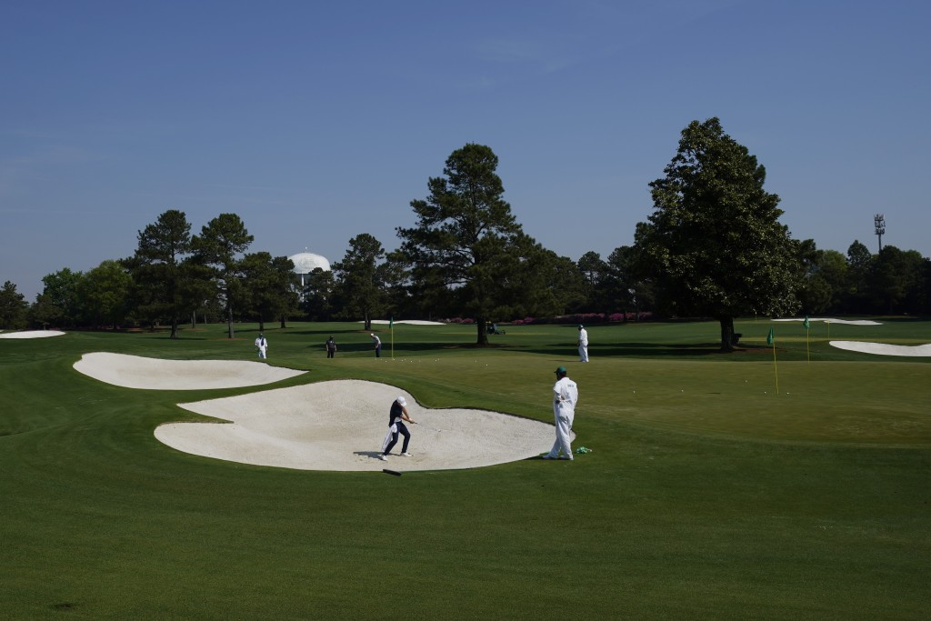 Jordan Spieth hits out of a bunker on the driving range during a practice round for the Masters golf tournament on Wednesday, April 7, 2021, in August...