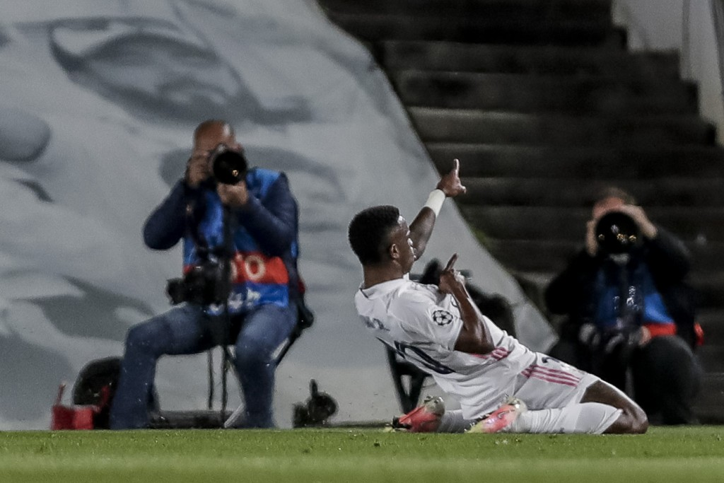 Real Madrid's Vinicius Junior celebrates after scoring the opening goal during the Champions League quarterfinal first leg, soccer match between Real ...