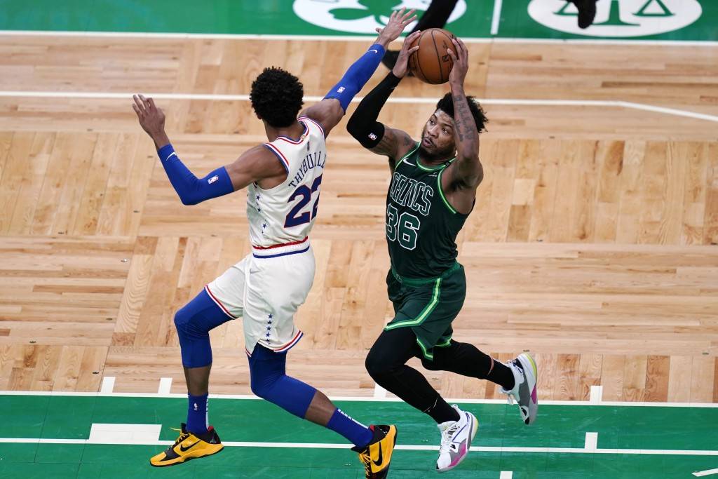 Boston Celtics guard Marcus Smart (36) tries to drive past Philadelphia 76ers guard Matisse Thybulle (22) during the first half of an NBA basketball g...