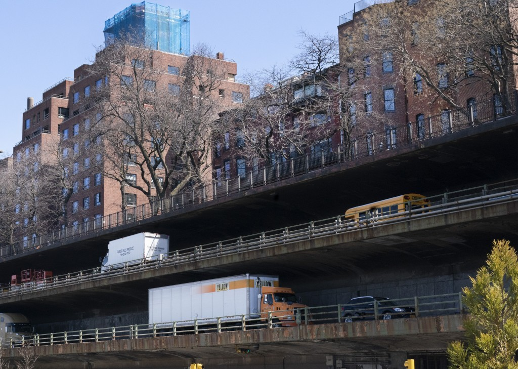 Vehicles drive along the Brooklyn Queens Expressway, part of the city's aging infrastructure, beneath the Brooklyn Heights promenade, Tuesday, April 6...