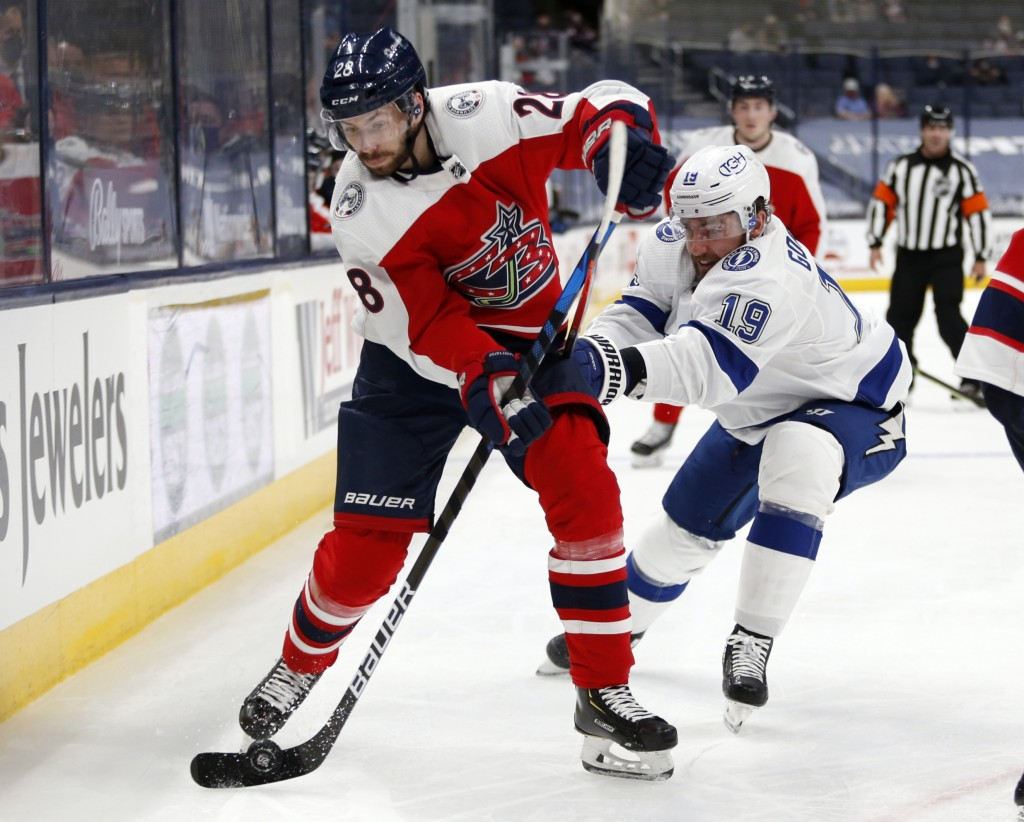 Columbus Blue Jackets forward Oliver Bjorkstrand, left, controls the puck in front of Tampa Bay Lightning forward Barclay Goodrow during the second pe...