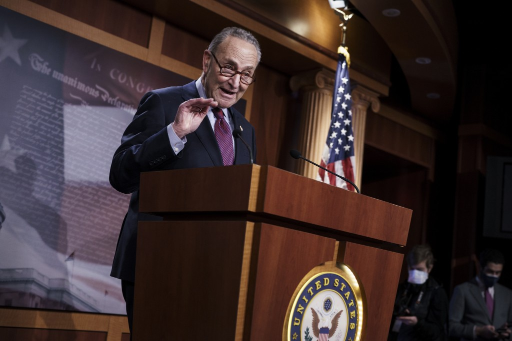FILE - In this March 6, 2021, file photo Senate Majority Leader Chuck Schumer, D-N.Y., speaks during a news conference at the Capitol in Washington. W...